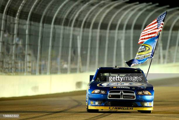 Brad Keselowski driver of the Miller Lite Dodge celebrates after winning the series championship and finishing in fifteenth place for the NASCAR...