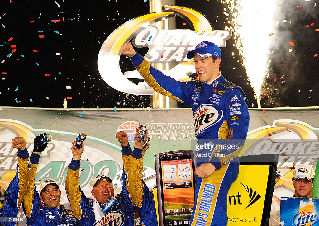 <a gi-track='captionPersonalityLinkClicked' href=/galleries/search?phrase=Brad+Keselowski&family=editorial&specificpeople=890258 ng-click='$event.stopPropagation()'>Brad Keselowski</a>, driver of the #2 Miller Lite Dodge, celebrates in Victory Lane after winning the NASCAR Sprint Cup Series Quaker State 400 at Kentucky Speedway on June 30, 2012 in Sparta, Kentucky.