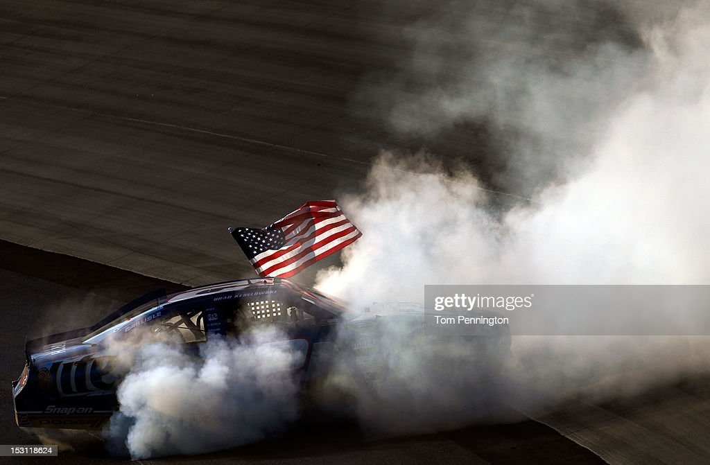 Brad Keselowski, driver of the #2 Miller Lite Dodge, celebrates with a burnout after winning the NASCAR Sprint Cup Series AAA 400 at Dover International Speedway on September 30, 2012 in Dover, Delaware.