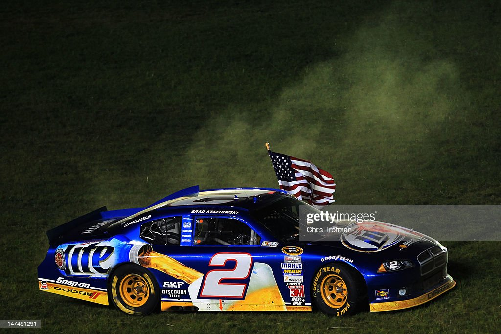 <a gi-track='captionPersonalityLinkClicked' href=/galleries/search?phrase=Brad+Keselowski&family=editorial&specificpeople=890258 ng-click='$event.stopPropagation()'>Brad Keselowski</a>, driver of the #2 Miller Lite Dodge, celebrates with the American flag after winning the NASCAR Sprint Cup Series Quaker State 400 at Kentucky Speedway on June 30, 2012 in Sparta, Kentucky.