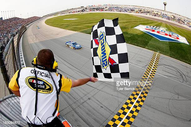 Brad Keselowski driver of the Miller Lite Dodge drives towards the start/finish line to take the checkered flag and win the NASCAR Sprint Cup Series...