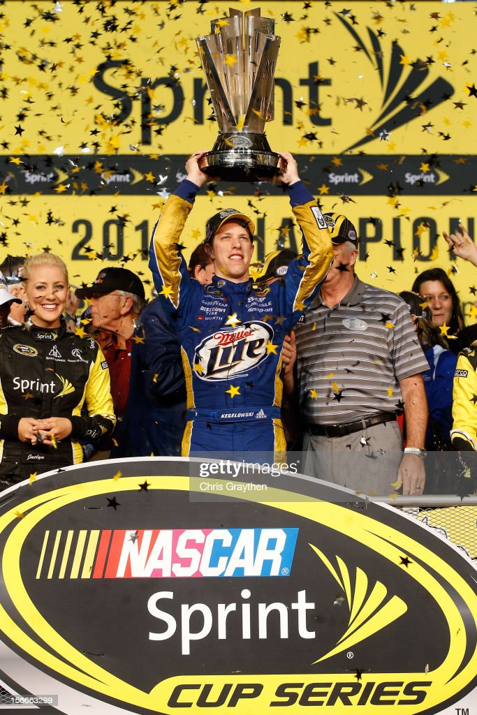 <a gi-track='captionPersonalityLinkClicked' href=/galleries/search?phrase=Brad+Keselowski&family=editorial&specificpeople=890258 ng-click='$event.stopPropagation()'>Brad Keselowski</a>, driver of the #2 Miller Lite Dodge, hoist the series trophy in Champions Victory Lane after winning the series championship and finishing in fifteenth place for the NASCAR Sprint Cup Series Ford EcoBoost 400 at Homestead-Miami Speedway on November 18, 2012 in Homestead, Florida.