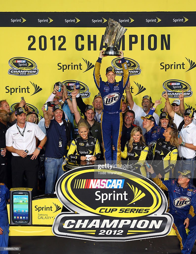 Brad Keselowski, driver of the #2 Miller Lite Dodge, hoist the series trophy in Champions Victory Lane after winning the series championship and finishing in fifteenth place for the NASCAR Sprint Cup Series Ford EcoBoost 400 at Homestead-Miami Speedway on November 18, 2012 in Homestead, Florida.