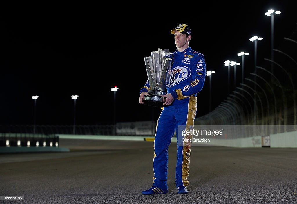 <a gi-track='captionPersonalityLinkClicked' href=/galleries/search?phrase=Brad+Keselowski&family=editorial&specificpeople=890258 ng-click='$event.stopPropagation()'>Brad Keselowski</a>, driver of the #2 Miller Lite Dodge, poses with the Series Championship Trophy after the NASCAR Sprint Cup Series Ford EcoBoost 400 at Homestead-Miami Speedway on November 18, 2012 in Homestead, Florida.