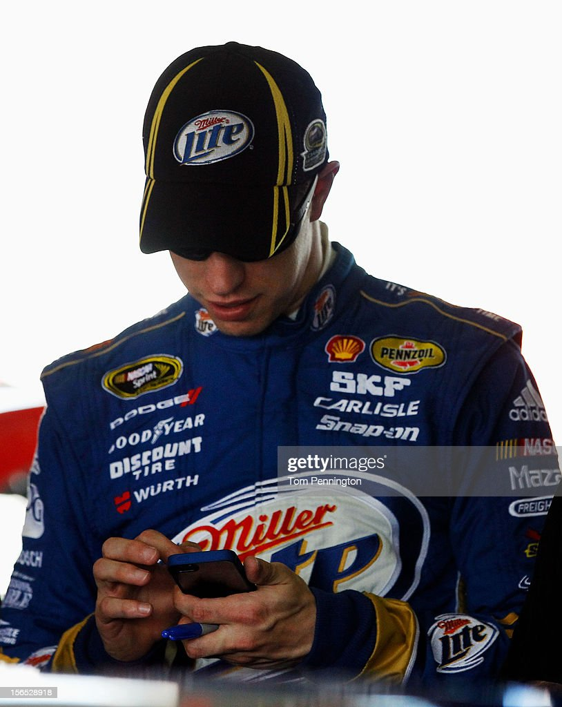 <a gi-track='captionPersonalityLinkClicked' href=/galleries/search?phrase=Brad+Keselowski&family=editorial&specificpeople=890258 ng-click='$event.stopPropagation()'>Brad Keselowski</a>, driver of the #2 Miller Lite Dodge, uses his smartphone in the garage area during practice for the NASCAR Sprint Cup Series Ford EcoBoost 400 at Homestead-Miami Speedway on November 16, 2012 in Homestead, Florida.