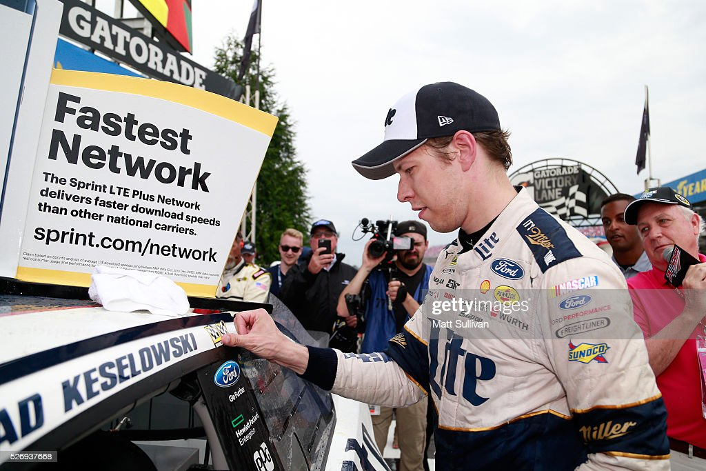 Brad Keselowski, driver of the #2 Miller Lite Ford, affixes the winner's decal on his car in Victory Lane after winning the NASCAR Sprint Cup Series GEICO 500 at Talladega Superspeedway on May 1, 2016 in Talladega, Alabama.