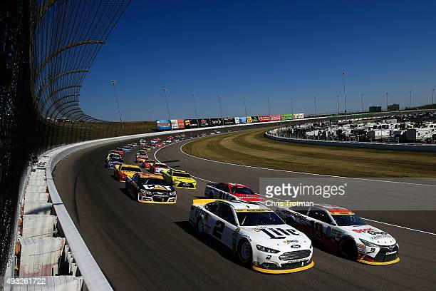Brad Keselowski driver of the Miller Lite Ford and Carl Edwards driver of the Sport Clips Toyota lead the field to a restart during the NASCAR Sprint...