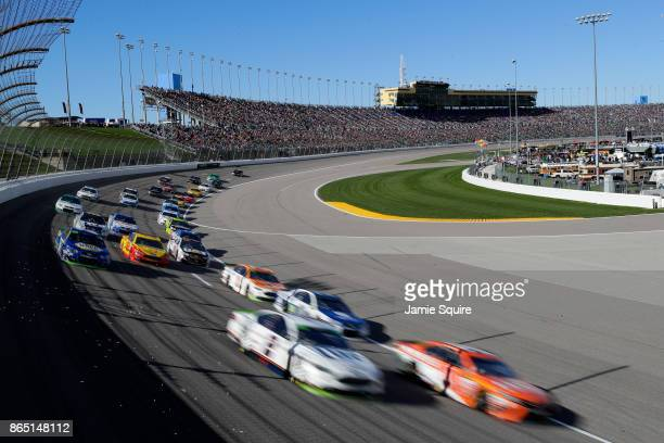 Brad Keselowski driver of the Miller Lite Ford and Daniel Suarez driver of the ARRIS Toyota lead a pack of cars during the Monster Energy NASCAR Cup...