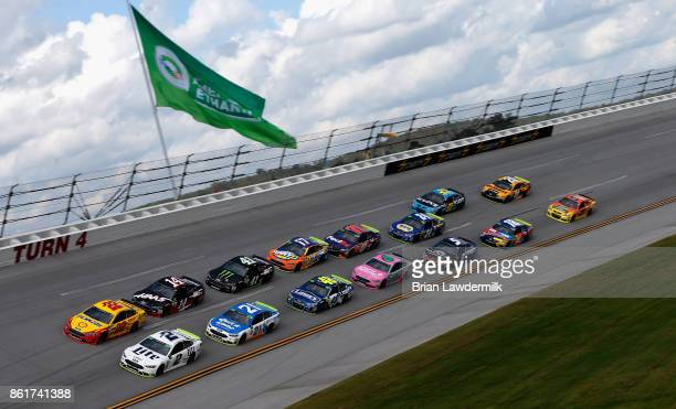 Brad Keselowski driver of the Miller Lite Ford and Joey Logano driver of the Shell Pennzoil Ford lead a pack of cars during the Monster Energy NASCAR...