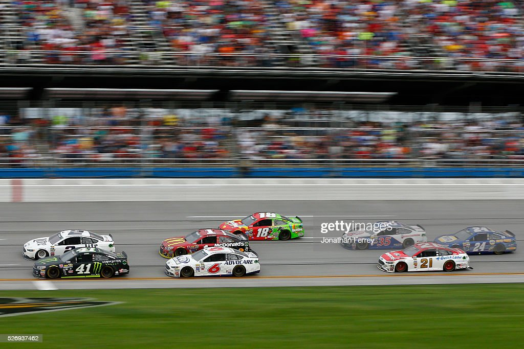 Brad Keselowski, driver of the #2 Miller Lite Ford, and Kurt Busch, driver of the #41 Monster Energy Chevrolet, lead a pack of cars during the NASCAR Sprint Cup Series GEICO 500 at Talladega Superspeedway on May 1, 2016 in Talladega, Alabama.