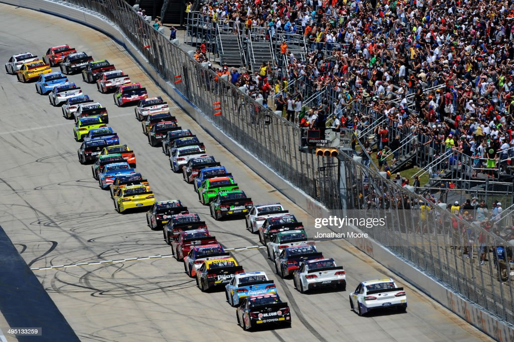 Brad Keselowski, driver of the #2 Miller Lite Ford, and Kyle Busch, driver of the #18 M&M's Peanut Butter Toyota, lead the field at the start of the NASCAR Sprint Cup Series FedEx 400 Benefiting Autism Speaks at Dover International Speedway on June 1, 2014 in Dover, Delaware.