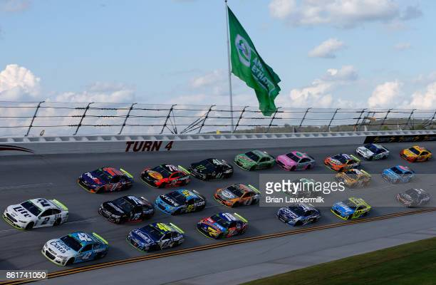 Brad Keselowski driver of the Miller Lite Ford and Kyle Larson driver of the First Data Chevrolet lead a pack of cars during the Monster Energy...