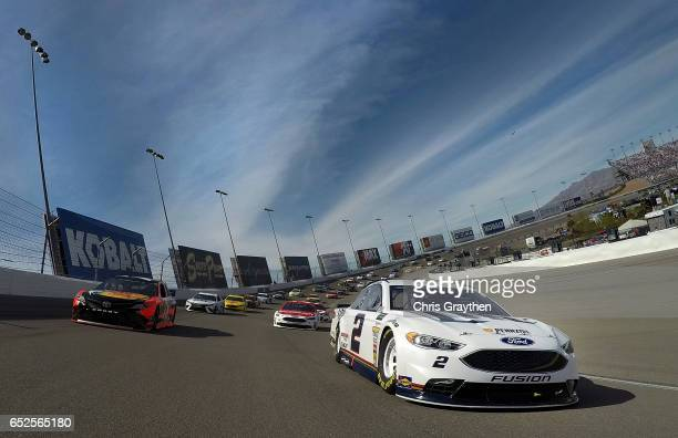 Brad Keselowski driver of the Miller Lite Ford and Martin Truex Jr driver of the Bass Pro Shops/TRACKER BOATS Toyota lead the field under caution...