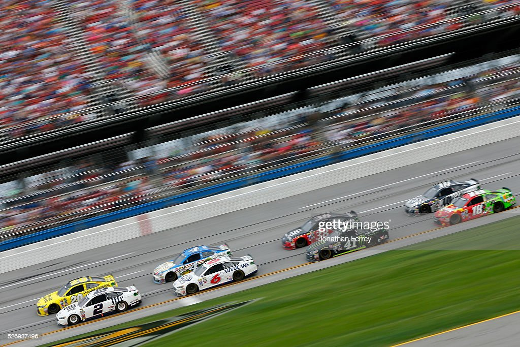 Brad Keselowski, driver of the #2 Miller Lite Ford, and Matt Kenseth, driver of the #20 Dollar General Toyota, lead a field during the NASCAR Sprint Cup Series GEICO 500 at Talladega Superspeedway on May 1, 2016 in Talladega, Alabama.