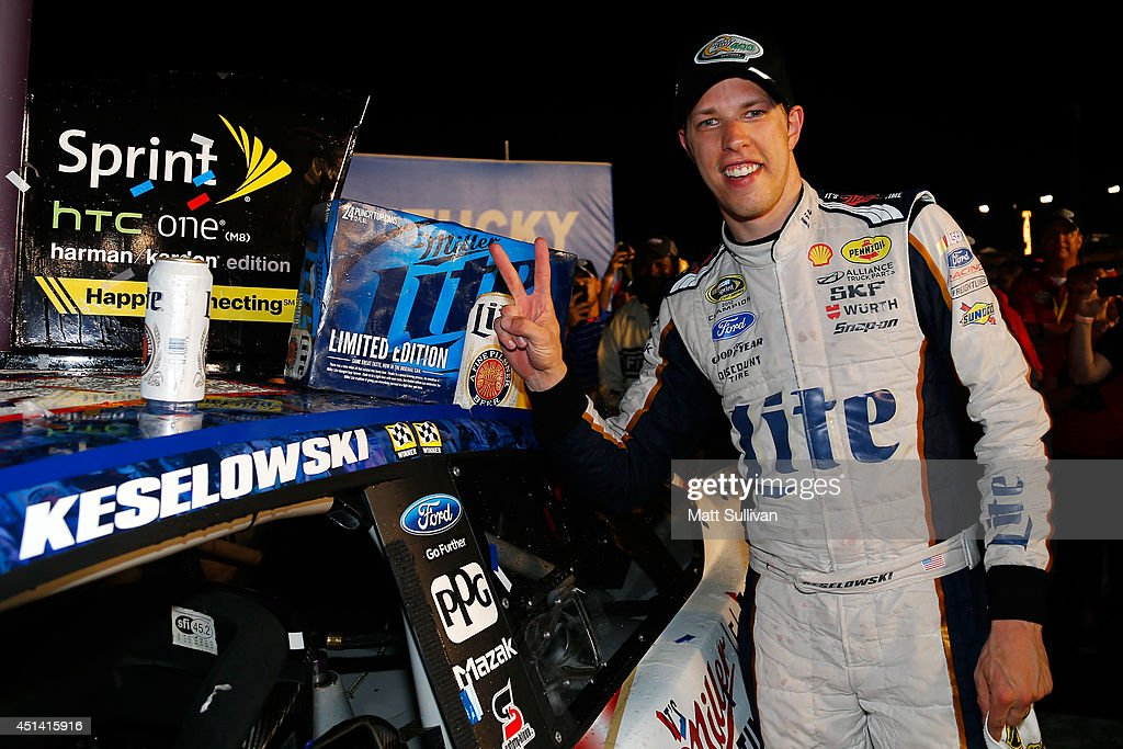 <a gi-track='captionPersonalityLinkClicked' href=/galleries/search?phrase=Brad+Keselowski&family=editorial&specificpeople=890258 ng-click='$event.stopPropagation()'>Brad Keselowski</a>, driver of the #2 Miller Lite Ford, applies the Winner's Decal after winning the NASCAR Sprint Cup Series Quaker State 400 presented by Advance Auto Parts at Kentucky Speedway on June 28, 2014 in Sparta, Kentucky.