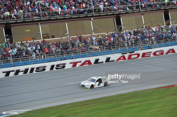 Brad Keselowski driver of the Miller Lite Ford celebrates after winning the Monster Energy NASCAR Cup Series Alabama 500 at Talladega Superspeedway...