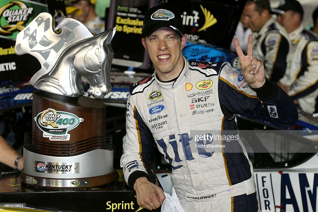 <a gi-track='captionPersonalityLinkClicked' href=/galleries/search?phrase=Brad+Keselowski&family=editorial&specificpeople=890258 ng-click='$event.stopPropagation()'>Brad Keselowski</a>, driver of the #2 Miller Lite Ford, celebrates in Victory Lane after winning the NASCAR Sprint Cup Series Quaker State 400 presented by Advance Auto Parts at Kentucky Speedway on June 28, 2014 in Sparta, Kentucky.