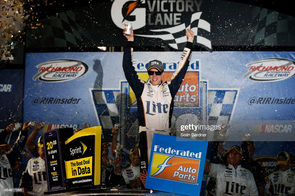 <a gi-track='captionPersonalityLinkClicked' href=/galleries/search?phrase=Brad+Keselowski&family=editorial&specificpeople=890258 ng-click='$event.stopPropagation()'>Brad Keselowski</a>, driver of the #2 Miller Lite Ford, celebrates in Victory Lane after winning during the NASCAR Sprint Cup Series Federated Auto Parts 400 at Richmond International Raceway on September 6, 2014 in Richmond, Virginia.