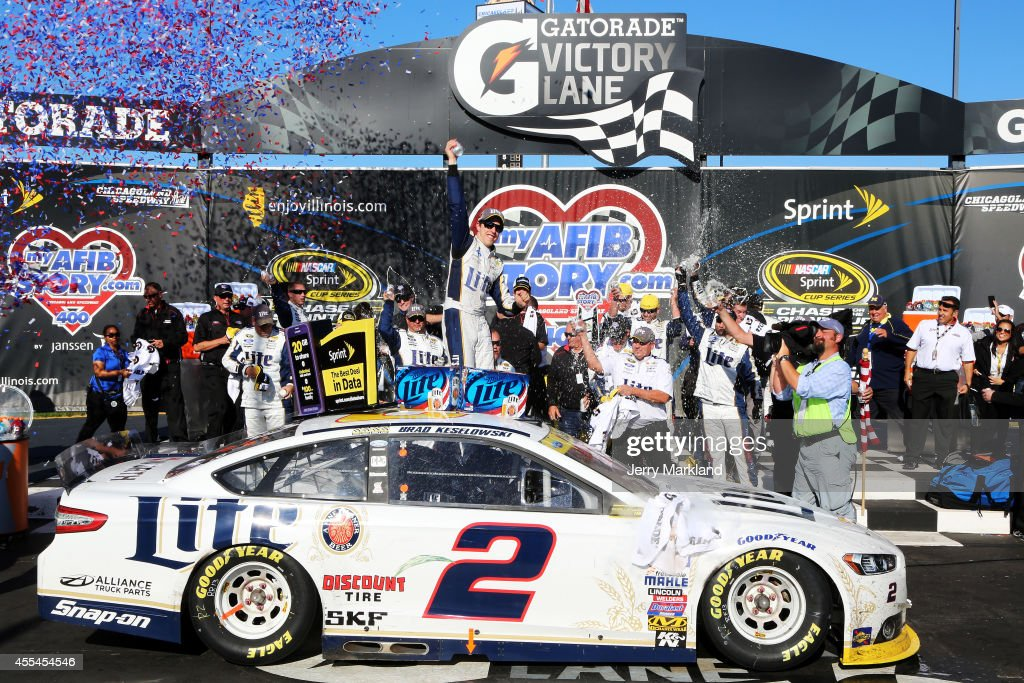 <a gi-track='captionPersonalityLinkClicked' href=/galleries/search?phrase=Brad+Keselowski&family=editorial&specificpeople=890258 ng-click='$event.stopPropagation()'>Brad Keselowski</a>, driver of the #2 Miller Lite Ford, celebrates in Victory Lane after winning during the NASCAR Sprint Cup Series MyAFibStory.com 400 at Chicagoland Speedway on September 14, 2014 in Joliet, Illinois.