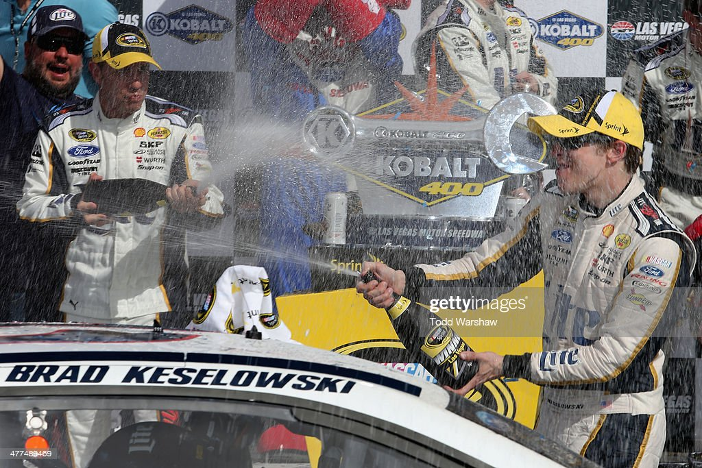 <a gi-track='captionPersonalityLinkClicked' href=/galleries/search?phrase=Brad+Keselowski&family=editorial&specificpeople=890258 ng-click='$event.stopPropagation()'>Brad Keselowski</a>, driver of the #2 Miller Lite Ford, celebrates in Victory Lane after winning the NASCAR Sprint Cup Series Kobalt 400 at Las Vegas Motor Speedway on March 9, 2014 in Las Vegas, Nevada.