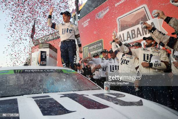Brad Keselowski driver of the Miller Lite Ford celebrates in victory lane after winning the Monster Energy NASCAR Cup Series Alabama 500 at Talladega...