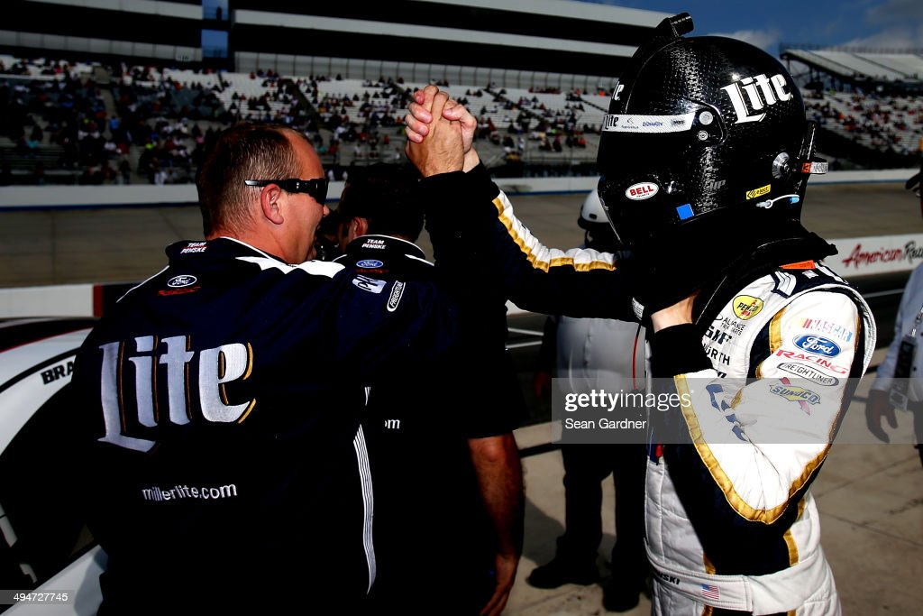 Brad Keselowski, driver of the #2 Miller Lite Ford, celebrates winning the pole position during qualifying for the NASCAR Sprint Cup Series FedEx 400 Benefiting Autism Speaks at Dover International Speedway on May 30, 2014 in Dover, Delaware.
