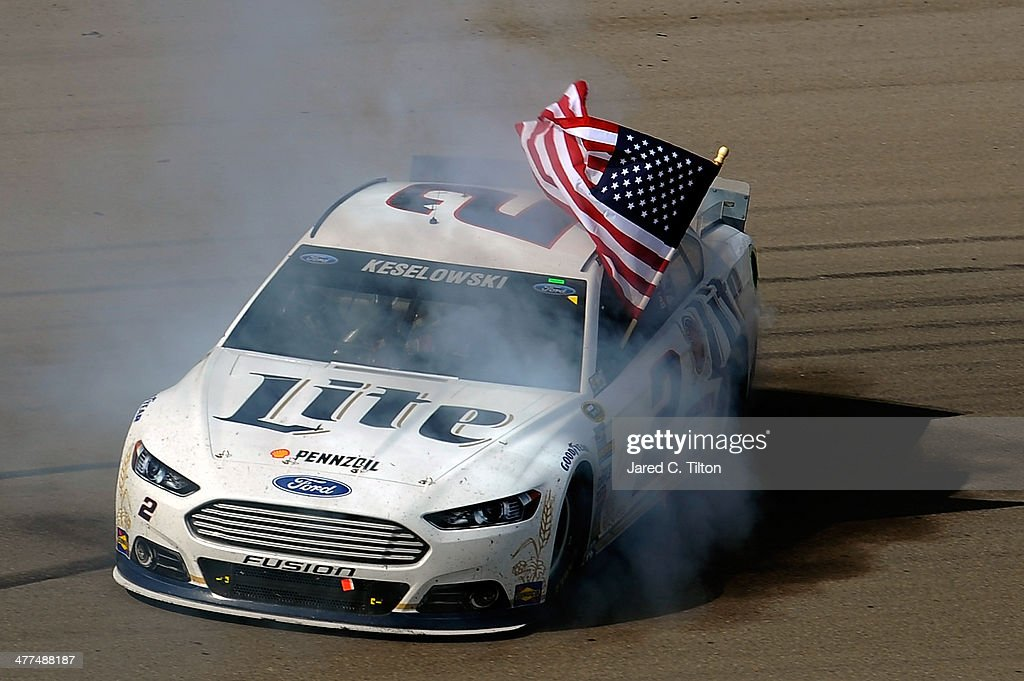 <a gi-track='captionPersonalityLinkClicked' href=/galleries/search?phrase=Brad+Keselowski&family=editorial&specificpeople=890258 ng-click='$event.stopPropagation()'>Brad Keselowski</a>, driver of the #2 Miller Lite Ford, celebrates with a burnout after winning the NASCAR Sprint Cup Series Kobalt 400 at Las Vegas Motor Speedway on March 9, 2014 in Las Vegas, Nevada.