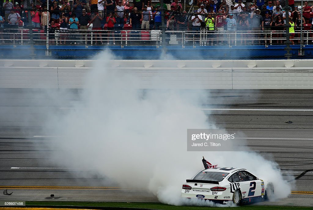 Brad Keselowski, driver of the #2 Miller Lite Ford, celebrates with a burnout after winning the NASCAR Sprint Cup Series GEICO 500 at Talladega Superspeedway on May 1, 2016 in Talladega, Alabama.