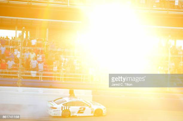 Brad Keselowski driver of the Miller Lite Ford celebrates with a burnout after winning the Monster Energy NASCAR Cup Series Alabama 500 at Talladega...