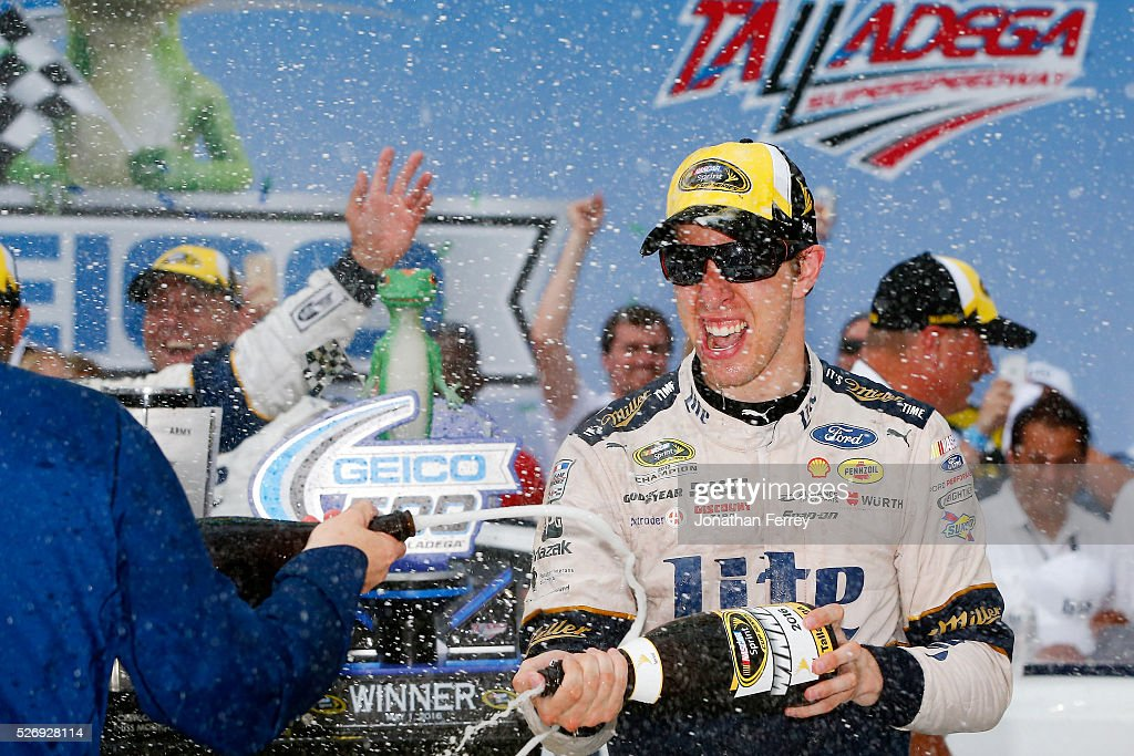 Brad Keselowski, driver of the #2 Miller Lite Ford, celebrates with champagne in Victory Lane after winning the NASCAR Sprint Cup Series GEICO 500 at Talladega Superspeedway on May 1, 2016 in Talladega, Alabama.