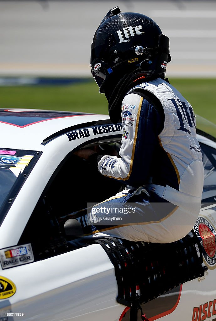 <a gi-track='captionPersonalityLinkClicked' href=/galleries/search?phrase=Brad+Keselowski&family=editorial&specificpeople=890258 ng-click='$event.stopPropagation()'>Brad Keselowski</a>, driver of the #2 Miller Lite Ford, climbs from his car during qualifying for the NASCAR Sprint Cup Series Aaron's 499 at Talladega Superspeedway on May 3, 2014 in Talladega, Alabama.