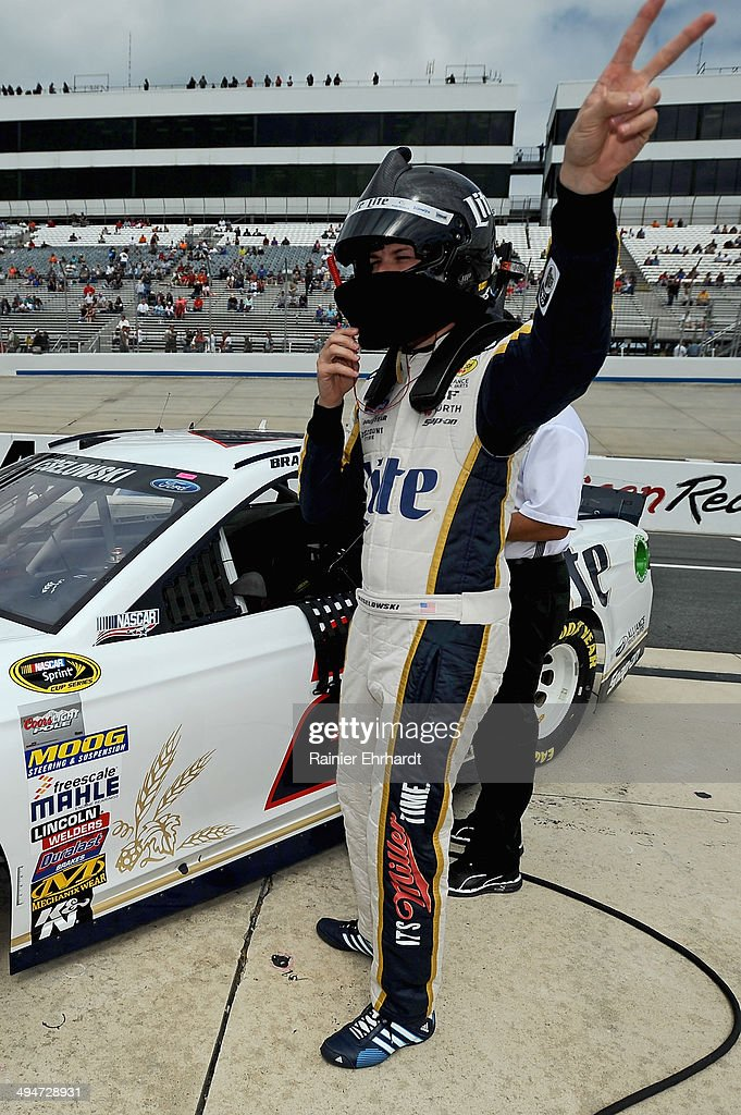 <a gi-track='captionPersonalityLinkClicked' href=/galleries/search?phrase=Brad+Keselowski&family=editorial&specificpeople=890258 ng-click='$event.stopPropagation()'>Brad Keselowski</a>, driver of the #2 Miller Lite Ford, climbs from his car after qualifying for the NASCAR Sprint Cup Series FedEx 400 Benefiting Autism Speaks at Dover International Speedway on May 30, 2014 in Dover, Delaware.