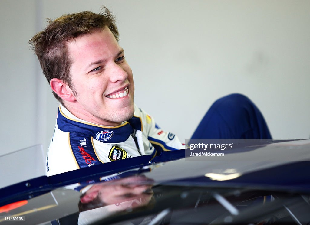 <a gi-track='captionPersonalityLinkClicked' href=/galleries/search?phrase=Brad+Keselowski&family=editorial&specificpeople=890258 ng-click='$event.stopPropagation()'>Brad Keselowski</a>, driver of the #2 Miller Lite Ford, climbs out of his car during practice for the NASCAR Sprint Cup Series Sylvania 300 at New Hampshire Motor Speedway on September 21, 2013 in Loudon, New Hampshire.