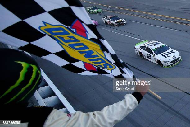 Brad Keselowski driver of the Miller Lite Ford crosses the finish line to win the Monster Energy NASCAR Cup Series Alabama 500 at Talladega...