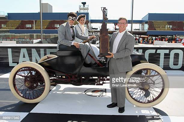 Brad Keselowski driver of the Miller Lite Ford drives a 1901 Sweepstakes exact replica on track with NBC's Kelli Stavast and deliveres the Heritage...