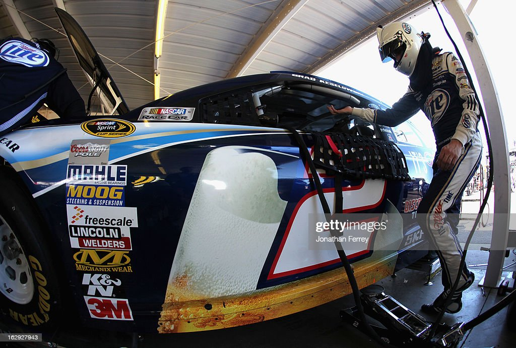 Brad Keselowski, driver of the #2 Miller Lite Ford, gets into his car in the garage during practice for the NASCAR Sprint Cup Series Subway Fresh Fit 500 at Phoenix International Raceway on March 1, 2013 in Avondale, Arizona.