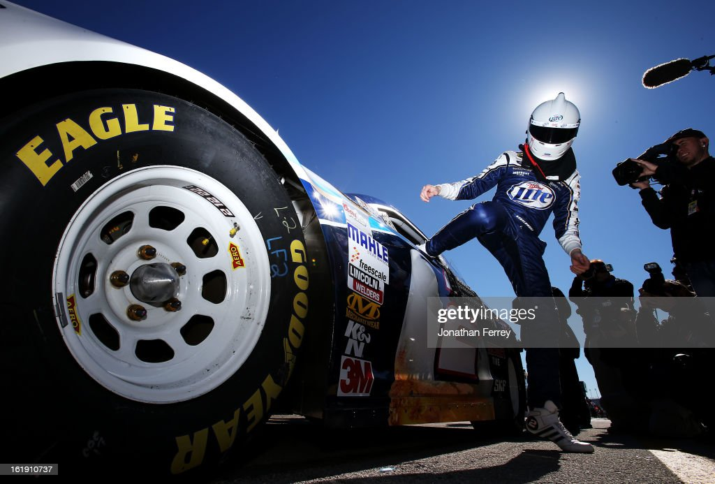 <a gi-track='captionPersonalityLinkClicked' href=/galleries/search?phrase=Brad+Keselowski&family=editorial&specificpeople=890258 ng-click='$event.stopPropagation()'>Brad Keselowski</a>, driver of the #2 Miller Lite Ford, gets out of his car after qualifying for the NASCAR Sprint Cup Series Daytona 500 at Daytona International Speedway on February 17, 2013 in Daytona Beach, Florida.
