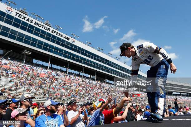 Brad Keselowski driver of the Miller Lite Ford greets fans during driver introductions prior to the Monster Energy NASCAR Cup Series O'Reilly Auto...