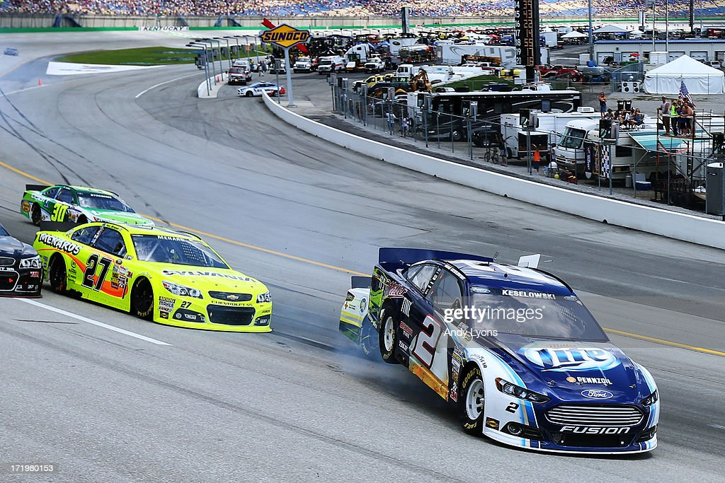Brad Keselowski, driver of the #2 Miller Lite Ford, Greg Biffle, driver of the #16 3M/National Fallen Firefighter's Foundation Ford, and Paul Menard, driver of the #27 Menards/Sylvania Chevrolet, are involved in an incident during the NASCAR Sprint Cup Series Quaker State 400 at Kentucky Speedway on June 30, 2013 in Sparta, Kentucky.