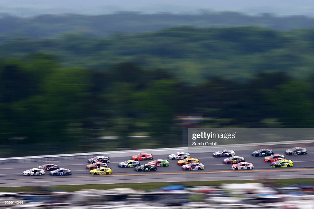 Brad Keselowski, driver of the #2 Miller Lite Ford, leads a pack of cars during the NASCAR Sprint Cup Series GEICO 500 at Talladega Superspeedway on May 1, 2016 in Talladega, Alabama.