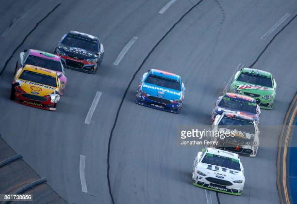 Brad Keselowski driver of the Miller Lite Ford leads a pack of cars during the Monster Energy NASCAR Cup Series Alabama 500 at Talladega...