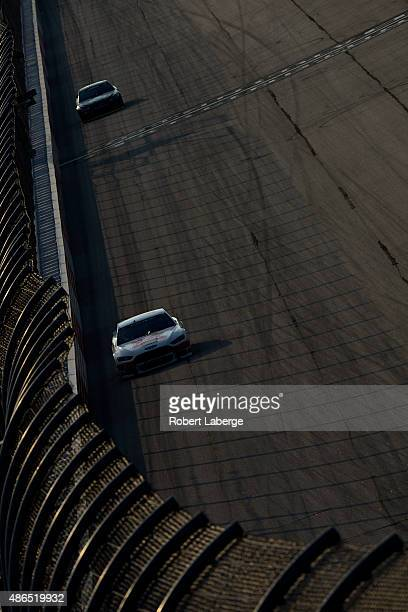 Brad Keselowski driver of the Miller Lite Ford leads Alex Bowman driver of the Tommy Baldwin Racing Chevrolet during practice for the NASCAR Sprint...