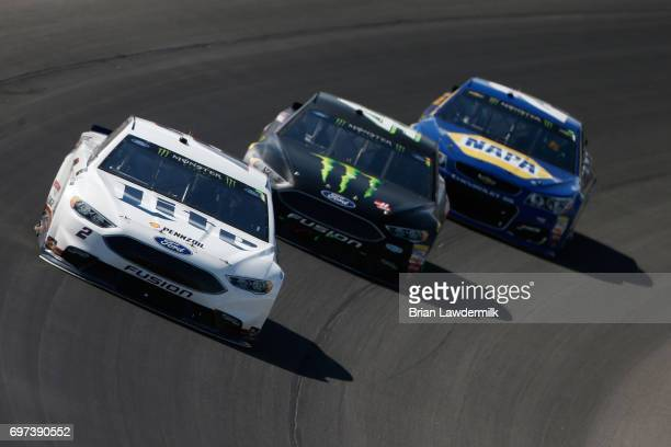 Brad Keselowski driver of the Miller Lite Ford leads Kurt Busch driver of the Monster Energy/Haas Automation Ford and Chase Elliott driver of the...