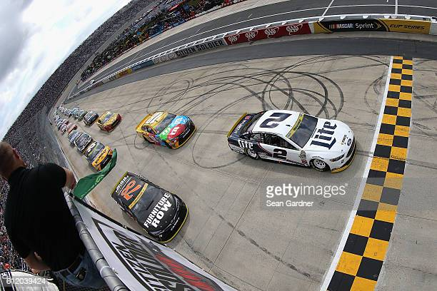 Brad Keselowski driver of the Miller Lite Ford leads the field past the green flag to start the NASCAR Sprint Cup Series Citizen Solider 400 at Dover...
