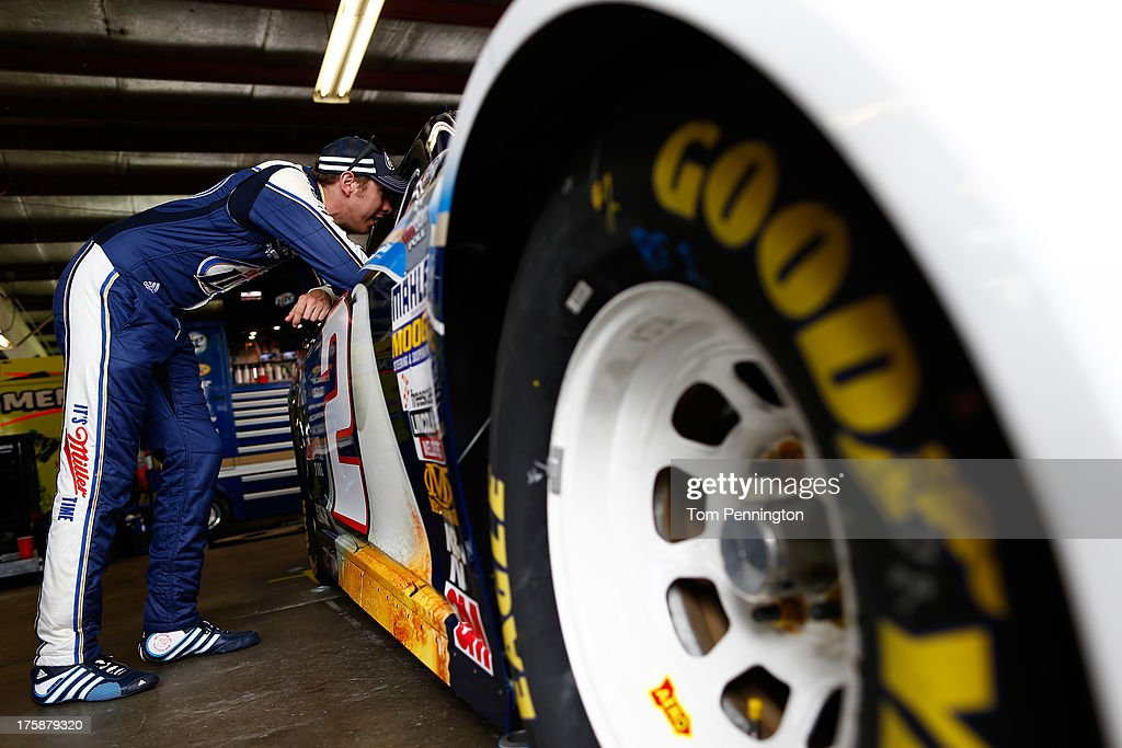 Brad Keselowski, driver of the #2 Miller Lite Ford, leans on his car in the garage area during practice for the NASCAR Sprint Cup Series Cheez-It 355 at Watkins Glen International on August 9, 2013 in Watkins Glen, New York.