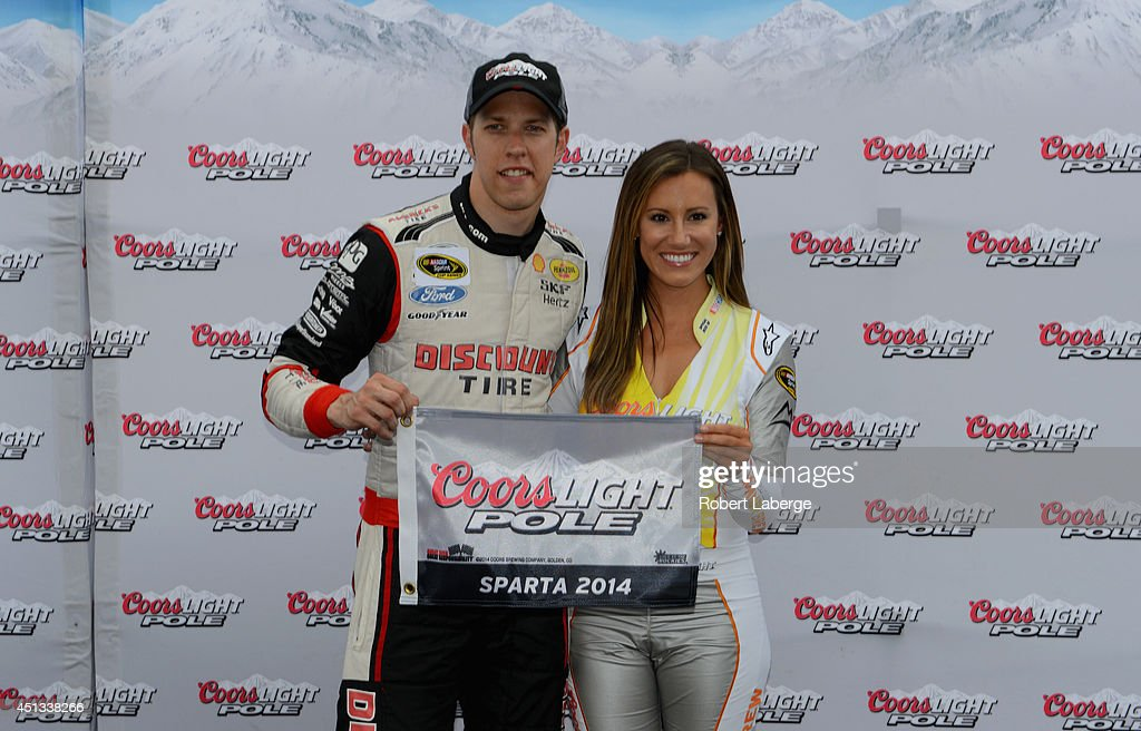 <a gi-track='captionPersonalityLinkClicked' href=/galleries/search?phrase=Brad+Keselowski&family=editorial&specificpeople=890258 ng-click='$event.stopPropagation()'>Brad Keselowski</a>, driver of the #2 Miller Lite Ford, left, poses with Miss Coors Light Rachel Rupert and the Coors Light Pole Award after qualifying for the pole for the NASCAR Sprint Cup Series Quaker State 400 presented by Advance Auto Parts at Kentucky Speedway on June 27, 2014 in Sparta, Kentucky.