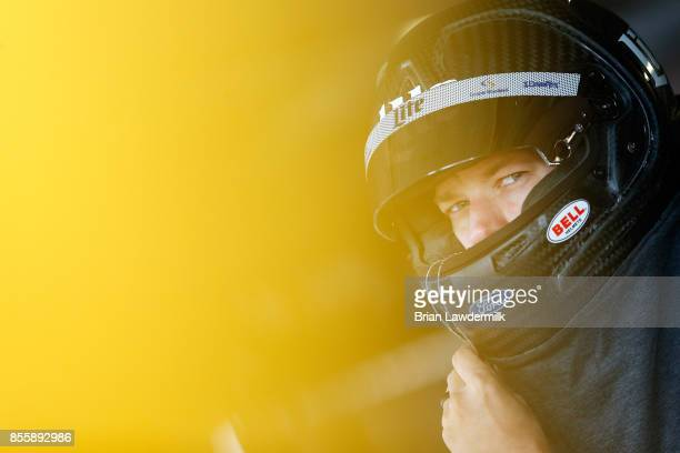 Brad Keselowski driver of the Miller Lite Ford looks on during practice for the Monster Energy NASCAR Cup Series Apache Warrior 400 presented by...