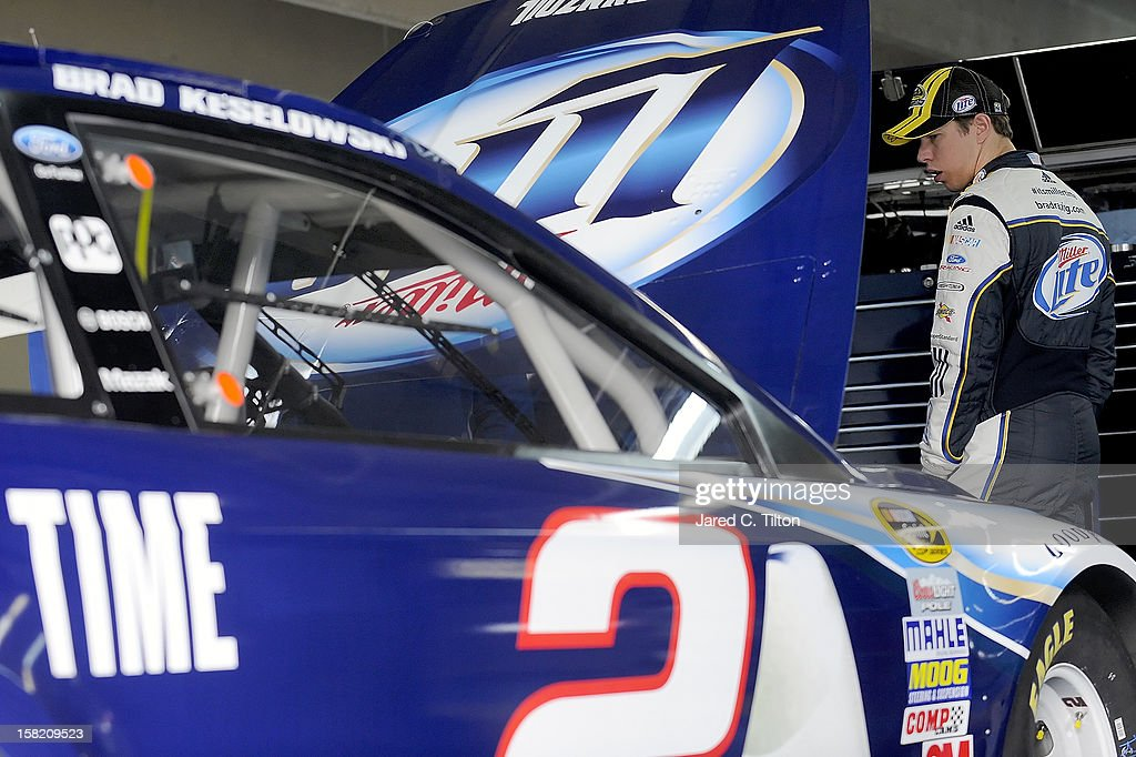 Brad Keselowski, driver of the #2 Miller Lite Ford, looks on in the garage area during testing at Charlotte Motor Speedway on December 11, 2012 in Concord, North Carolina.