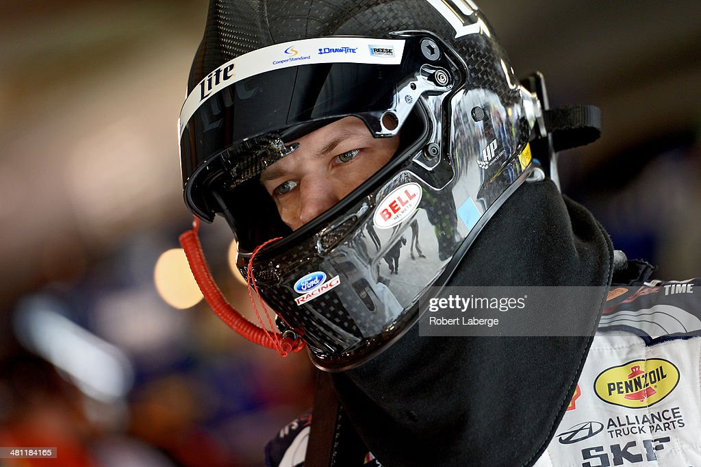 Brad Keselowski, driver of the #2 Miller Lite Ford, looks on in the garage area during qualifying for the NASCAR Sprint Cup Series STP 500 at Martinsville Speedway on March 28, 2014 in Martinsville, Virginia.