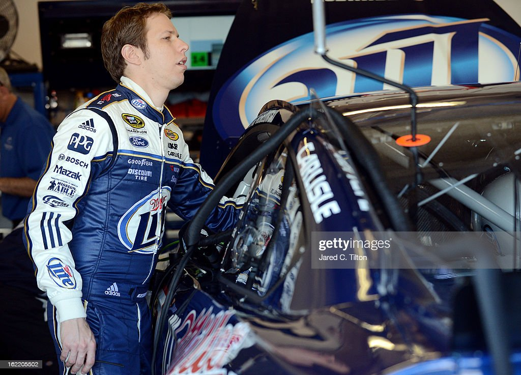 Brad Keselowski, driver of the #2 Miller Lite Ford, looks over his car in the garage during practice for the NASCAR Sprint Cup Series Daytona 500 at Daytona International Speedway on February 20, 2013 in Daytona Beach, Florida.